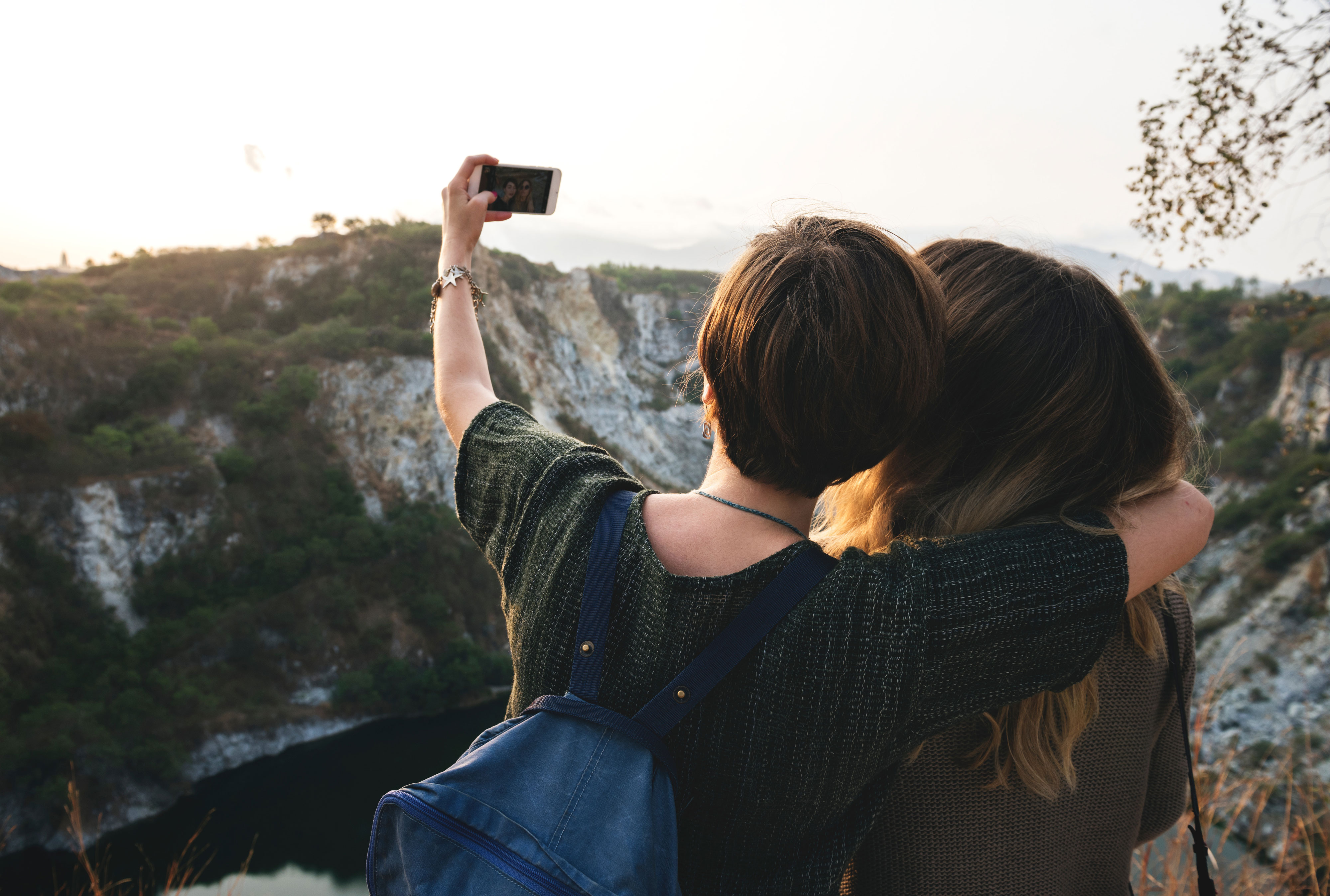 Couple take a selfie photograph in mountain landscape